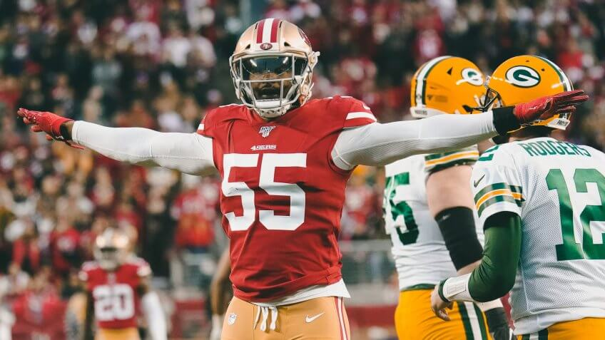 San Francisco 49ers defensive end Dee Ford (55) gestures next to Green Bay Packers quarterback Aaron Rodgers (12) during the first half of the NFL NFC Championship football game, in Santa Clara, CalifNFC Championship Packers 49ers Football, Santa Clara, USA - 19 Jan 2020.