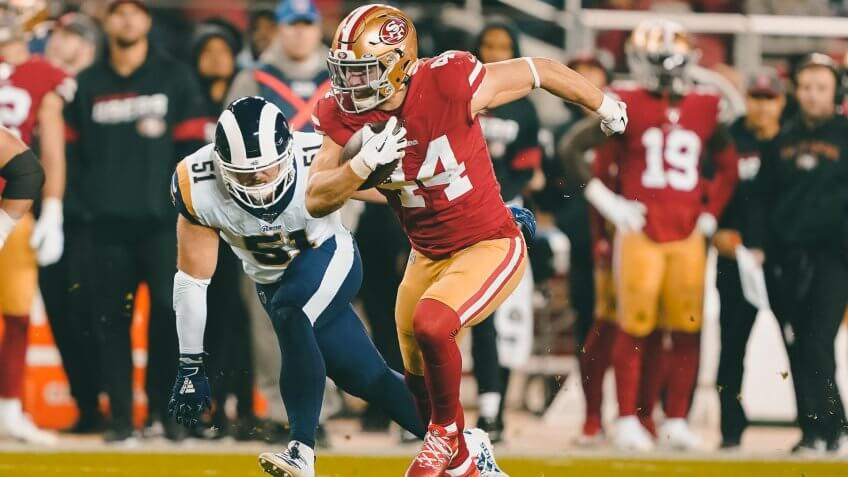 San Francisco 49ers fullback Kyle Juszczyk (44) runs against Los Angeles Rams linebacker Troy Reeder (51) during the first half of an NFL football game in Santa Clara, CalifRams 49ers Football, Santa Clara, USA - 21 Dec 2019.