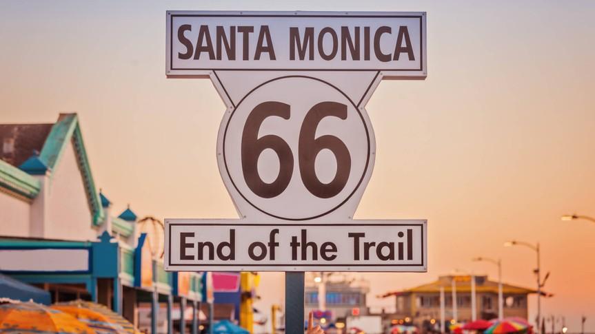 Historic Route 66 sign on pierce of Santa Monica California.
