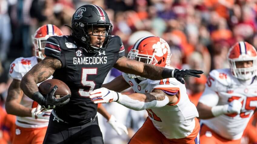 Mandatory Credit: Photo by Sean Rayford/AP/Shutterstock (10488737i)South Carolina running back Rico Dowdle (5) carries the ball against Clemson linebacker Isaiah Simmons (11) during the first half of an NCAA college football game, in Columbia, S.