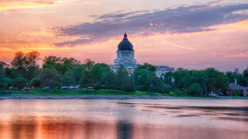 PIERRE, SD - JULY 9, 2018: South Dakota Capital Building along Capitol Lake in Pierre, SD at sunset.