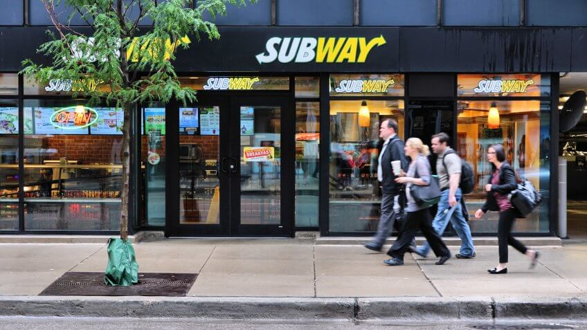 CHICAGO, USA - JUNE 26, 2013: People walk past Subway sandwich store in Chicago.