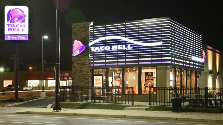Dayton, Ohio, USA - December 13, 2015: Taco Bell Restaurant, shown here at night in its newer 2013 purple design, has recently announced its implementation of exclusively using cage-free eggs in its 6000 US locations by the end of 2016.