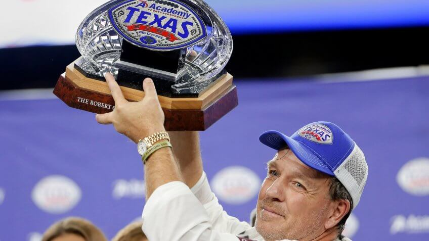 Mandatory Credit: Photo by Michael Wyke/AP/Shutterstock (10513792m)Texas A&M coach Jimbo Fisher holds up the Texas Bowl trophy after the team's 24-21 win over Oklahoma State in the NCAA college football game, in HoustonTexas Bowl Football, Houston, USA - 27 Dec 2019.