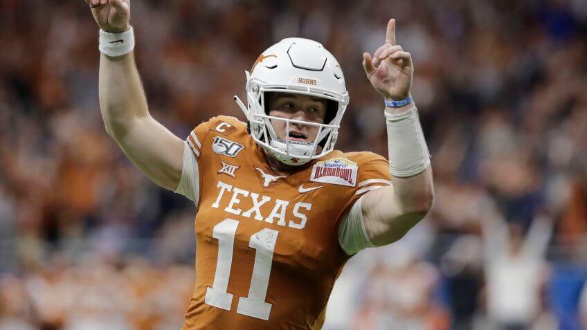 Mandatory Credit: Photo by Austin Gay/AP/Shutterstock (10516720a)Texas quarterback Sam Ehlinger (11) during the first half of the Alamo Bowl NCAA college football game against Utah in San AntonioTexas Football, San Antonio, USA - 31 Dec 2019.