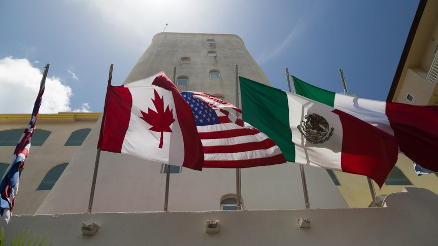 Flags of Canada, USA and Mexico together waving in the wind.