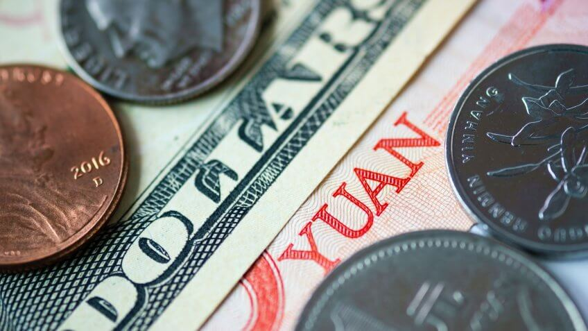 Close up banknote and coins of US dollar and Yuan which its are the biggest economic in the world.