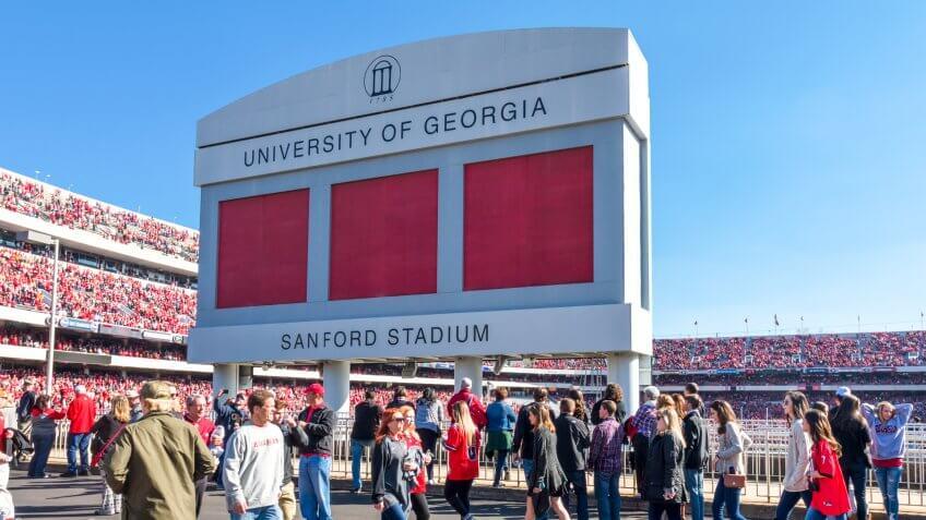 Athens, Georgia, United States: November 26, 2017: Crowd passes under Sanford Stadium Sign on Game Day.