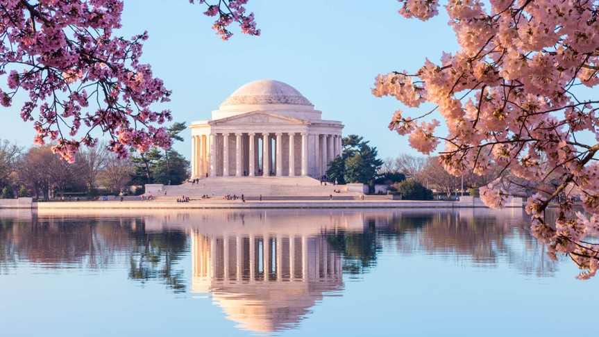 Sun rising illuminates the Jefferson Memorial and Tidal Basin.