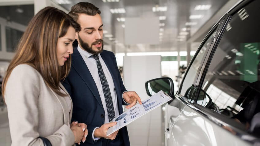car agent with customer in showroom
