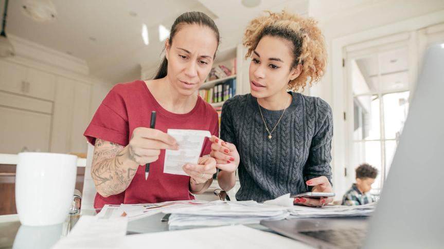 LGBTQ couple dealing with finances.