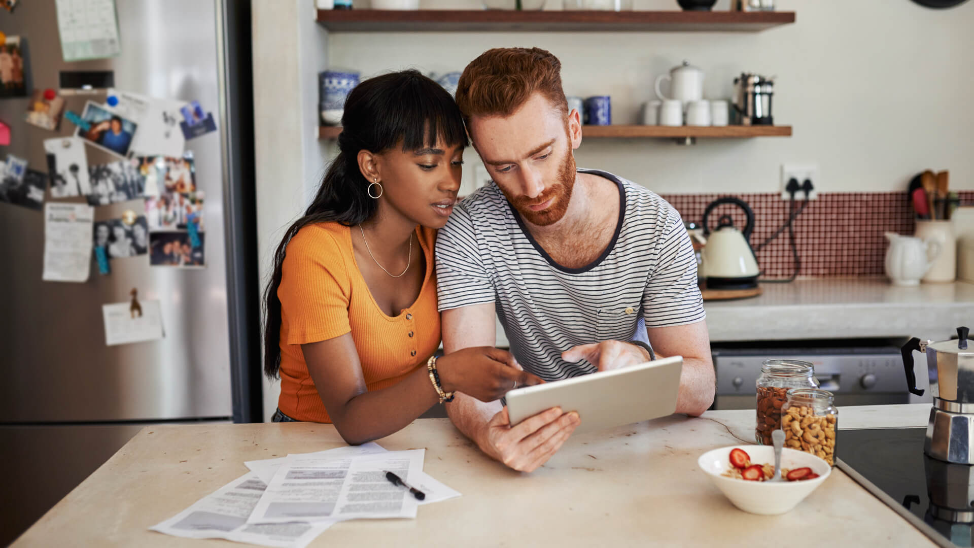 Shot of a young couple using a digital tablet at home.