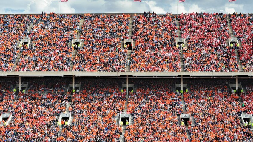 football fans stand in the nosebleed section