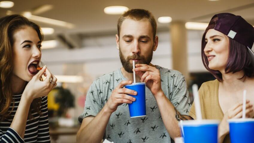 friends drinking from soda cups