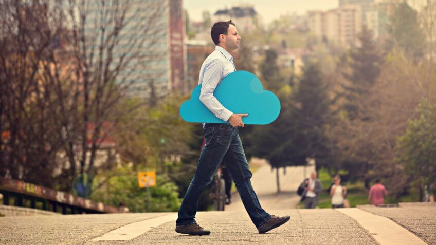 Young man with blue cloud on the street.