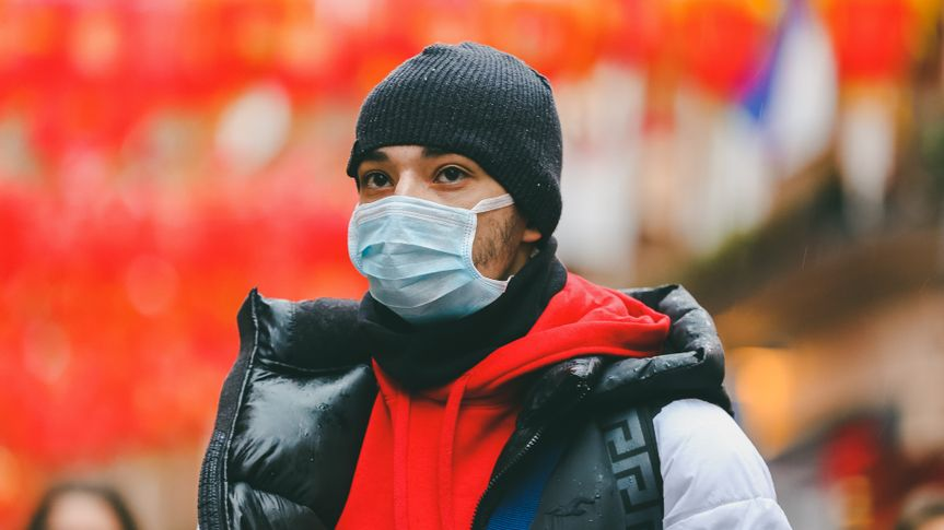 A man in Chinatown in central London is seen wearing a face mask following the outbreak of Coronavirus in China which has killed 41 people.