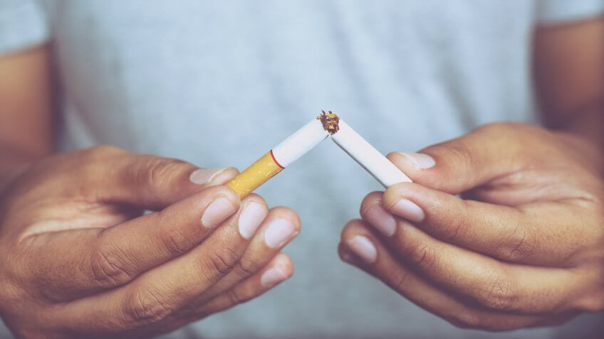 Man refusing cigarettes concept for quitting smoking and healthy lifestyle.