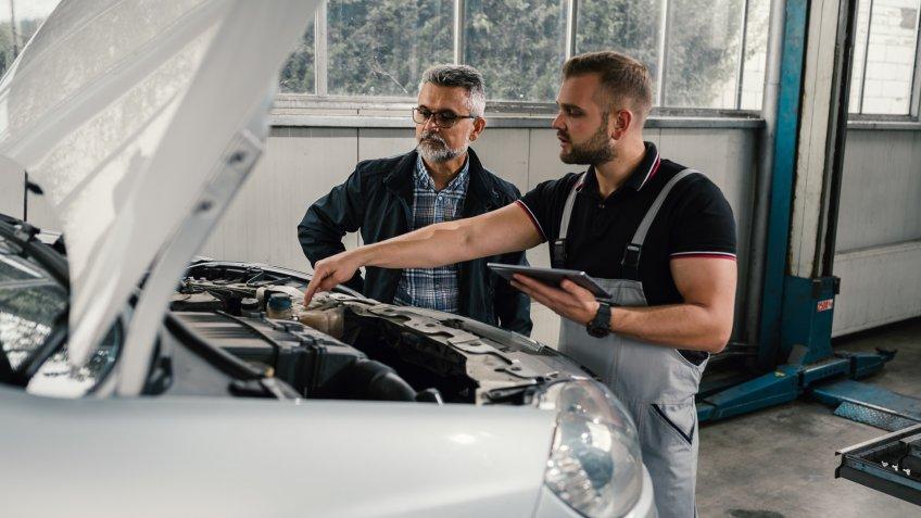 Auto mechanic with customer.