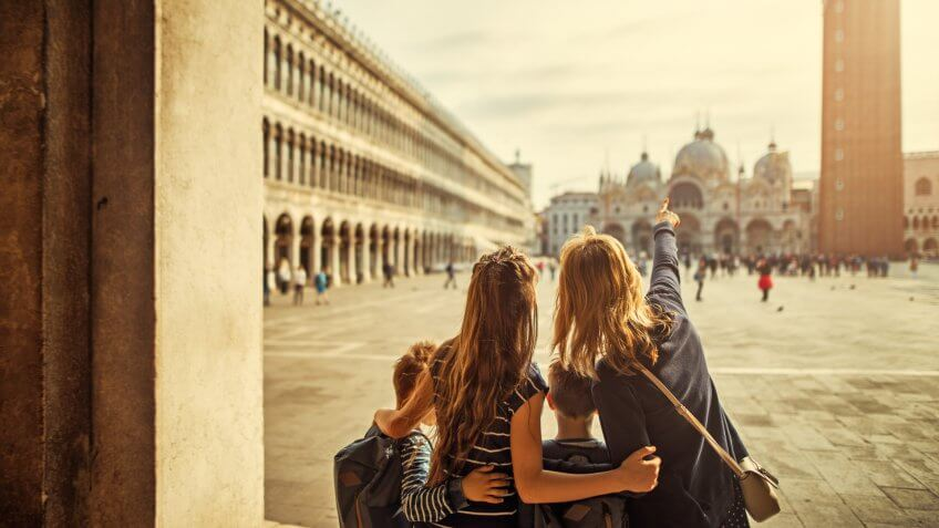 Mother and three kids visiting Venice, Italy.