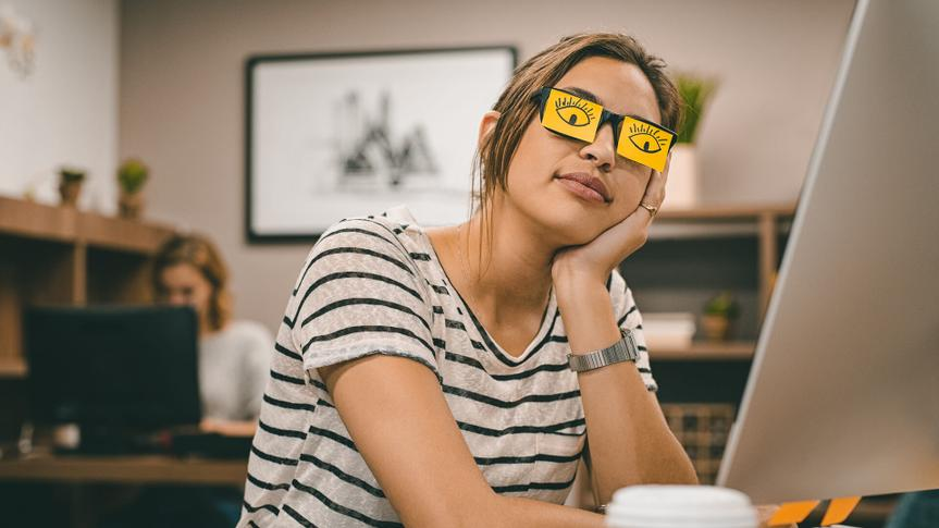 Sleeping businesswoman covering her eyes with sticky notes on eyeglasses.