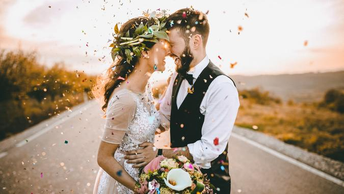 wedding couple in love with confetti