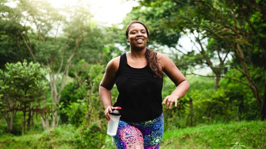 Brazilian woman body positive exercising in nature.