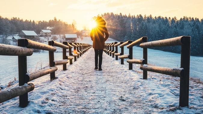 Woman walking at the frozen lake.