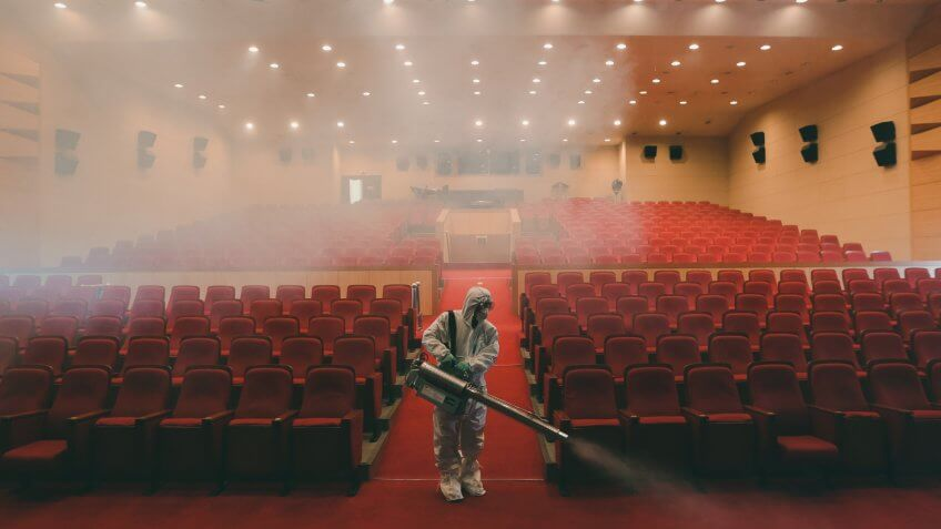 A worker wearing protective gears sprays antiseptic solution as a precaution against the spread of MERS, Middle East Respiratory Syndrome, virus at an art hall in Seoul, South Korea, .