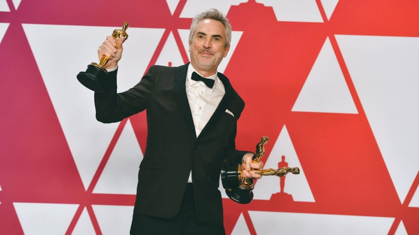 """Alfonso Cuaron poses with the awards for best director for """"Roma"""", best foreign language film for """"Roma"""", and best cinematography for """"Roma"""" in the press room at the Oscars, at the Dolby Theatre in Los Angeles91st Academy Awards - Press Room, Los Angeles, USA - 24 Feb 2019."""
