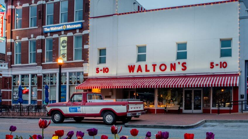 Bentonville, AR—April 11, 2019; old red and white ford truck that belonged to Sam Walton parked in front of first Walmart store which now serves as a corporate museum near the Arkansas headquarters.