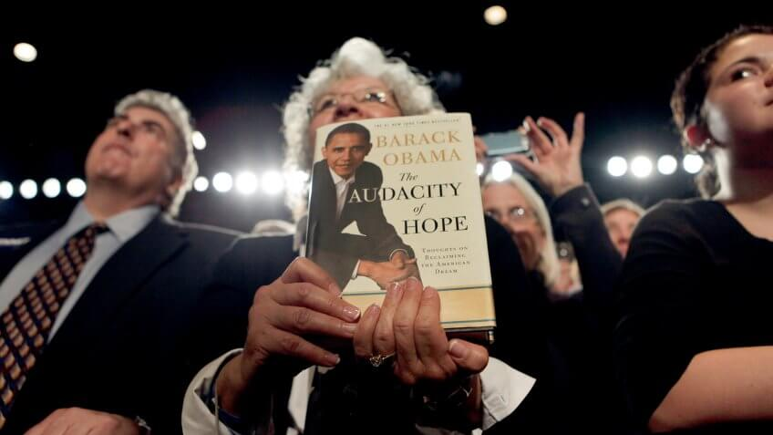 A member of the audience holds a copy of President Barack Obama's book 'The Audacity of Hope' during a fundraiser for Sen.