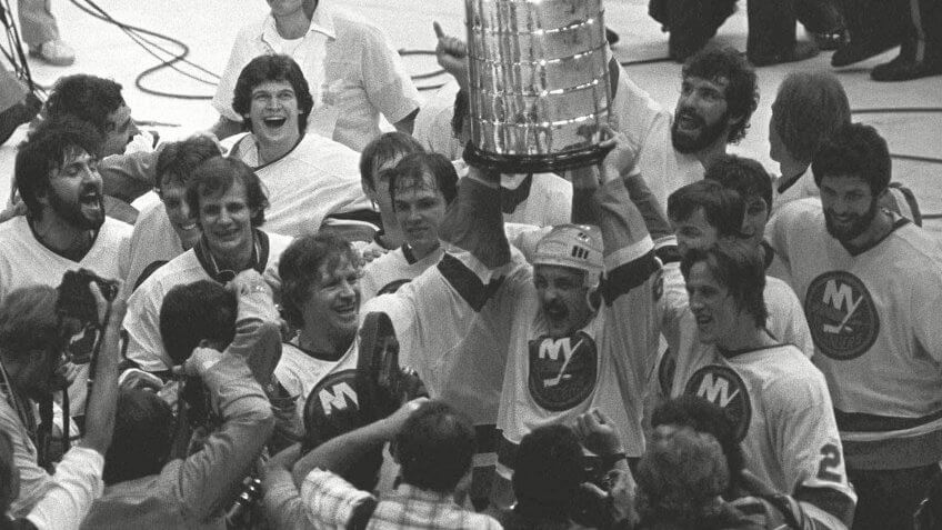 CUP New York Islanders Bryan Trottier, center, holds aloft the Stanley Cup as his teammates celebrate their second consecutive championshipSTANLEY CUP FINAL, UNIONDALE, USA.