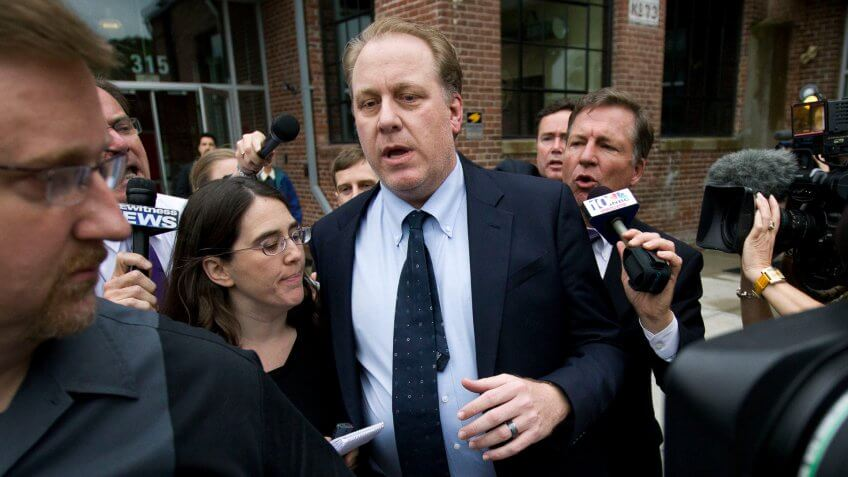 Curt Schilling Former Boston Red Sox pitcher Curt Schilling, center, is followed by members of the media as he departs the Rhode Island Economic Development Corporation headquarters, in Providence, R.