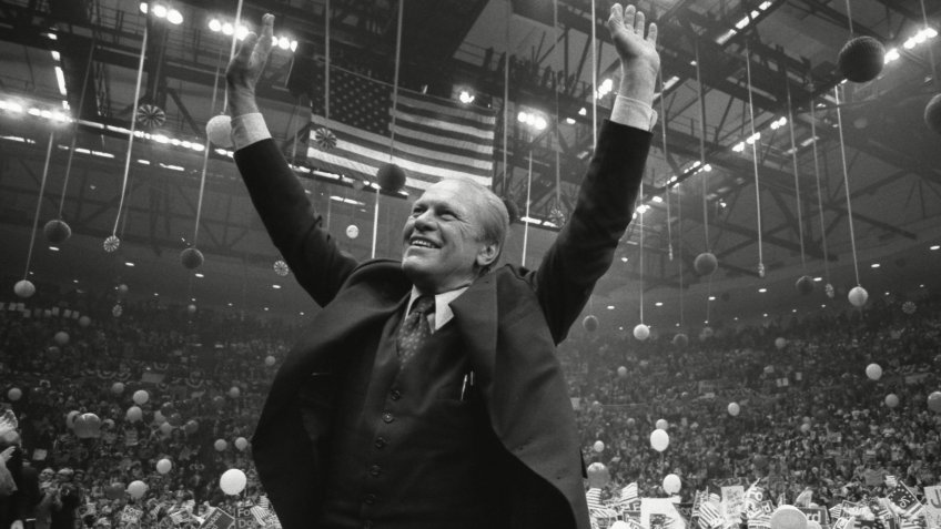 President Ford Acknowledges the cheers of the crowd in the Hempstead New York in the final days of his Presidential campaign.