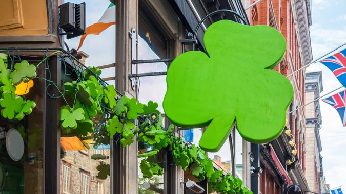 Outside street view of irish pub decorated with shamrocks for St Patricks Day.