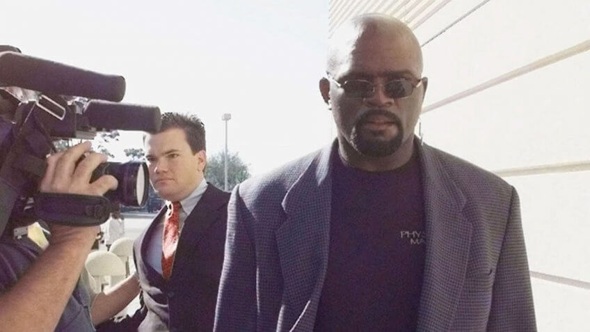 TAYLOR NFL Hall of Famer and former New York Giants player Lawrence Taylor, right, walks through a line of photographers as he heads into the Pinellas County courthouse in Clearwater, Fla.