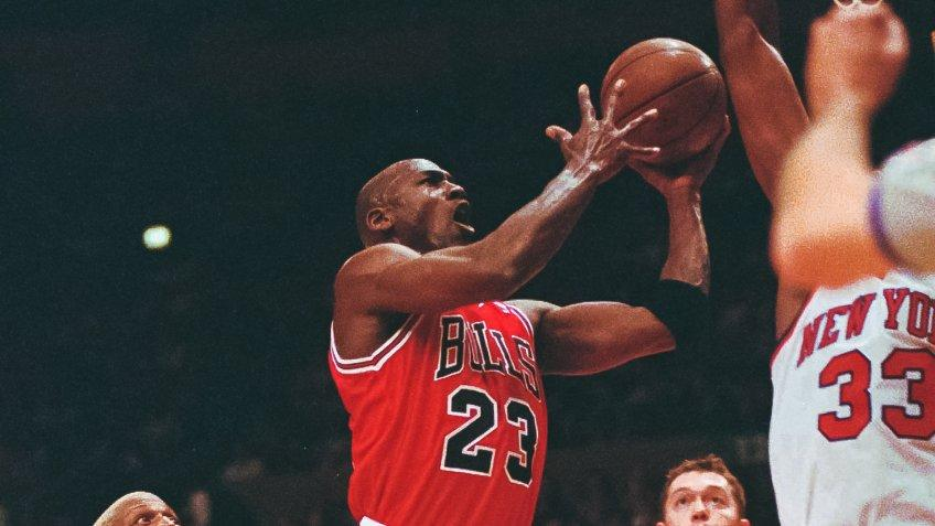 EWING Chicago Bulls guard Michael Jordan (23) drives to the basket in front of New York Knicks center Patrick Ewing (33) in the first half of game four of the Eastern Conference semi-finals Sunday evening at New York's Madison Square Garden.