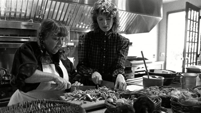 "MARTHA STEWART Martha Stewart, right, cook and author of a new book, ""Entertaining,"" and her friend and restaurant consultant Ruth Leserman of San Francisco, chop mushrooms while preparing dishes for a luncheon."