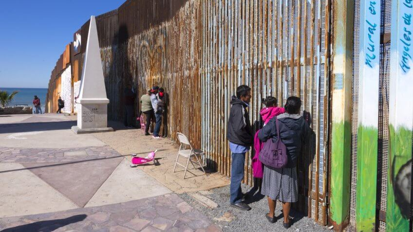 PLAYAS DE TIJUANA, MEXICO - JANUARY 28, 2017: Mexican families living in Tijuana visit with family living in the U.