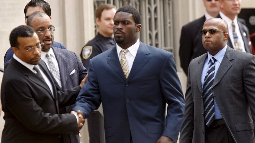 Nfl Quarterback Michael Vick Shakes Hands with His Lawyers As He Arrives at the U S District Court House to Plead Guilty to a Federal Conspiracy Charge That He Helped Run an Interstate Dogfighting Operation in Richmond Virginia Usa 27 August 2007 the Nfl On 24 August Suspended Vick Indefinitely Without Pay After He Filed the Plea Agreement with League Commissioner Roger Goodell Calling the Operation 'Cruel and Reprehensible'Usa Vick Trial - Aug 2007.