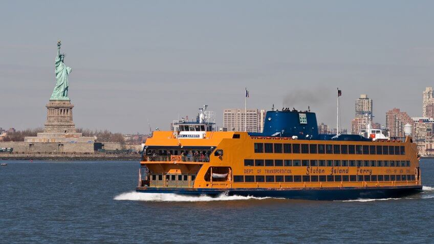 """New York City, NY, USA - March 6, 2012: The Staten Island Ferry leaving Manhattan."