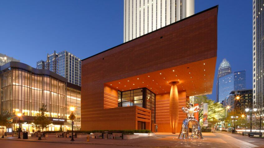 """Charlotte, North Carolina, USA - April 2, 2011: The Bechtler Museum of Modern Art and Firebird statue lights up night in uptown Charlotte."