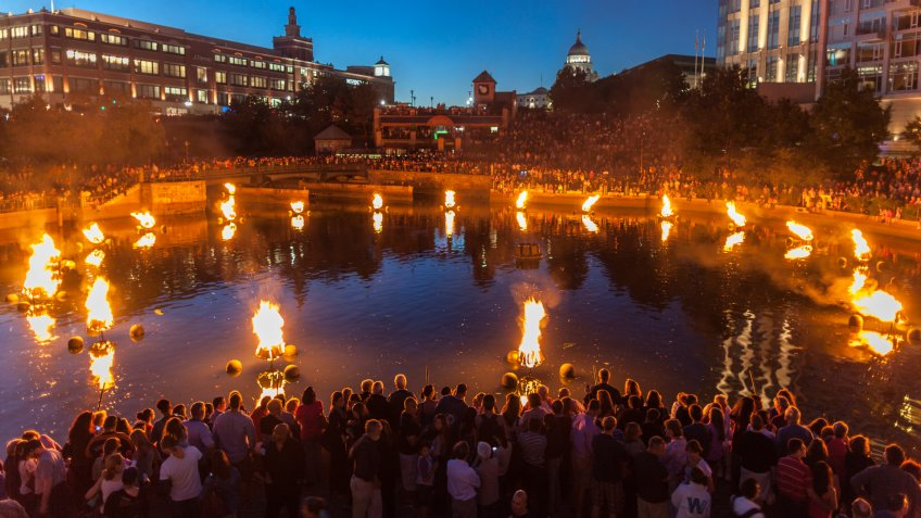 """Providence, Rhode Island, USA - August 24, 2013: People line the banks of the Providence River to enjoy Waterfire."