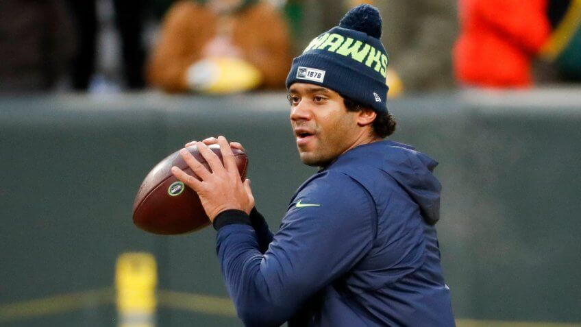 Seattle Seahawks quarterback Russell Wilson warms up before an NFL divisional playoff football game against the Seattle Seahawks, in Green Bay, WisSeahawks Packers Football, Green Bay, USA - 12 Jan 2020.