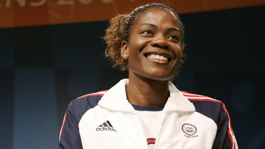 Basketball star Sheryl Swoopes smiles during a team news conference in AthensGREECE OLYMPICS BASKETBALL, ATHENS, Greece.