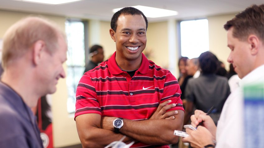 Tiger Woods Tigers Woods smiles as he answers questions for local journalist after speaking at Cesar Chavez Charter High School in Washington, .