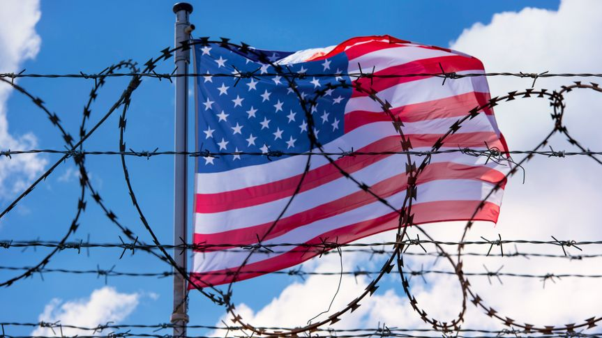 USA Border with American Flag and barbed Wire.
