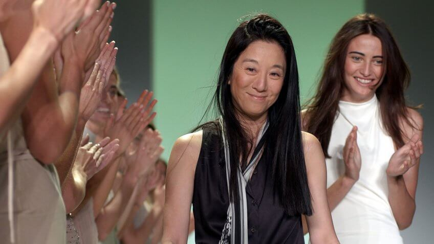WANG Designer Vera Wang, center, as she is applauded by her models and the audience following the presentation of her spring-summer 2003 collection in New York.