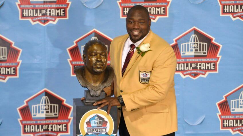 Hall of Fame inductee Warren Sapp poses with his bust during the 2013 Pro Football Hall of Fame Induction Ceremony, in Canton, OhioHall of Fame Football, Canton, USA - 3 Aug 2013.