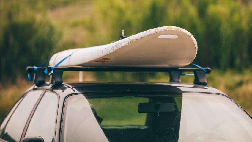 Windsurfing board on the top of the car.
